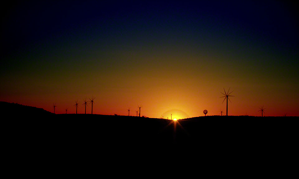 WindTurbinesAtSunset